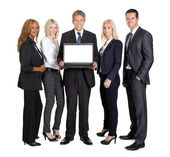 Group of business advertising a new laptop — Stock Photo