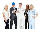 Groep in verschillende beroepen op wit — Stockfoto