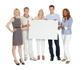 Casual group of holding a billboard — Stock Photo