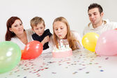 Young family celebrating birthday at home — Stock Photo