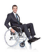 Young businessman in wheelchair — Stock Photo
