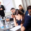 Foto de Stock  : Businessmat sales meeting discussing targets