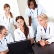 Portrait of mature young doctors working together — Stock Photo