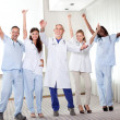 Foto Stock: Group of happy doctors smiling and waving
