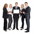 Stock Photo: Business group pointing at the laptop
