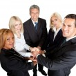 Successful businesspeople stacking their hands — Stock Photo