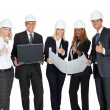 Smiling construction workers with building plan — Stock Photo