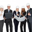 Smiling construction workers with building plan - Stock Photo