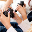 Stock Photo: Kids playing console games using joystick