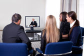 Businesspeople at a video conference — Stock Photo
