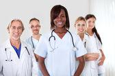 Group of successful happy multi-ethnic doctors — Stock Photo