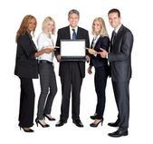 Business group pointing at the laptop — Stock Photo