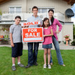 Young family happy to have bought a home — Stock Photo