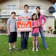 Young family happy to have bought a home - Stock Photo