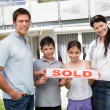 Smiling young family buying new house — Stock Photo #20231357