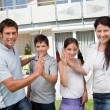 Excited family celebrating buying new house — Stock Photo