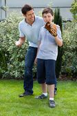Cute little boy playing baseball with his father — Stock Photo