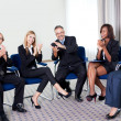Stock Photo: Team of happy successful businesspeople