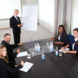 Business meeting - man presenting his ideas — Stock Photo