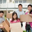 Young family shifting into new house — Stock Photo