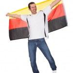 ドイツの旗を保持している幸せな男の肖像 — ストック写真