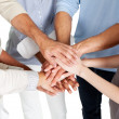 Stacked hands symbolizing team effort — Stock Photo