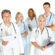 Diverse team of doctors and surgeons on white - Photo