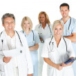 Diverse team of doctors and surgeons on white — Stock Photo