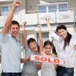 Happy family celebrating buying their new house - Stok fotoğraf