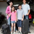 Happy family going on holiday - Stock Photo