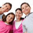 Portrait of young family looking happy - Stock Photo