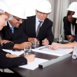Stock Photo: Happy successful engineers brainstorming