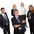 Confident business leader with his team - Stock Photo