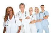 Friendly team of doctors smiling over white — Stock Photo