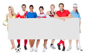 Group of sports presenting empty banner — Stock Photo