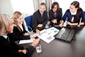 Young pretty females with mature business managers — Stock Photo