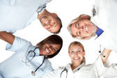 Multi racial group or happy doctors smiling — Stock Photo