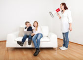 Mom screaming at kids using megaphone — Stock Photo