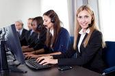 Closeup portrait of pretty customer care operator — Stock Photo