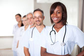 Multi-ethnic team of confident happy doctors — Stock Photo