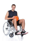 Man in wheelchair playing basketball — Stock Photo