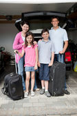 Happy family going on holiday — Stock Photo