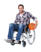 Man in wheelchair with basketball — Stock Photo