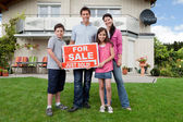 Happy family buying new house — Stock Photo