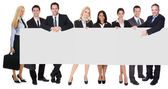 Group of business presenting empty banner — Stock Photo