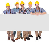 Construction workers presenting empty banner — Stock Photo