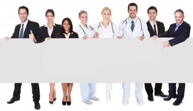 Doctors and managers presenting empty banner