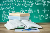 School textbooks on a desk — Stock Photo