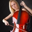 Beautiful young woman playing cello — Stockfoto