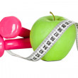 Apple wrapped in measuring tape. Diet concept. Isolated in white - Stock Photo